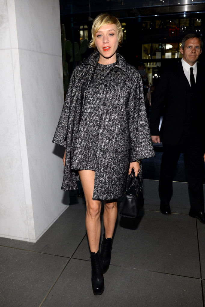 Chloë Sevigny arrived at the Dolce & Gabbana party in a matching minidress and swing coat, only adding the chicest black accessories to the mix.