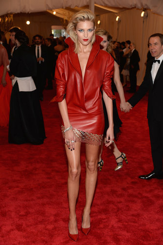 Anja Rubik looked fierce in a red leather Anthony Vaccarello minidress — with pointy pumps and lips to match. She finished the look with Chopard jewels.