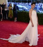 Katie Holmes was ethereal in a white chiffon Calvin Klein Collection halter gown and Lorraine Schwartz jewels.