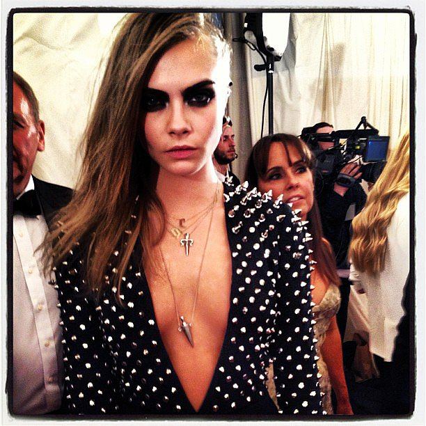 Cara Delevingne rocked a dangerously low custom-made Burberry dress on the red carpet. Source: Instagram user voguemagazine
