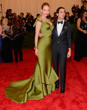 On the arm of Zac Posen? Uma Thurman, in a rich green frock with train.