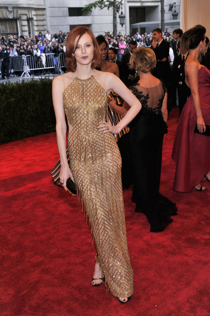 Karen Elson shimmered in a gold beaded and fringe Julien MacDonald halter gown.