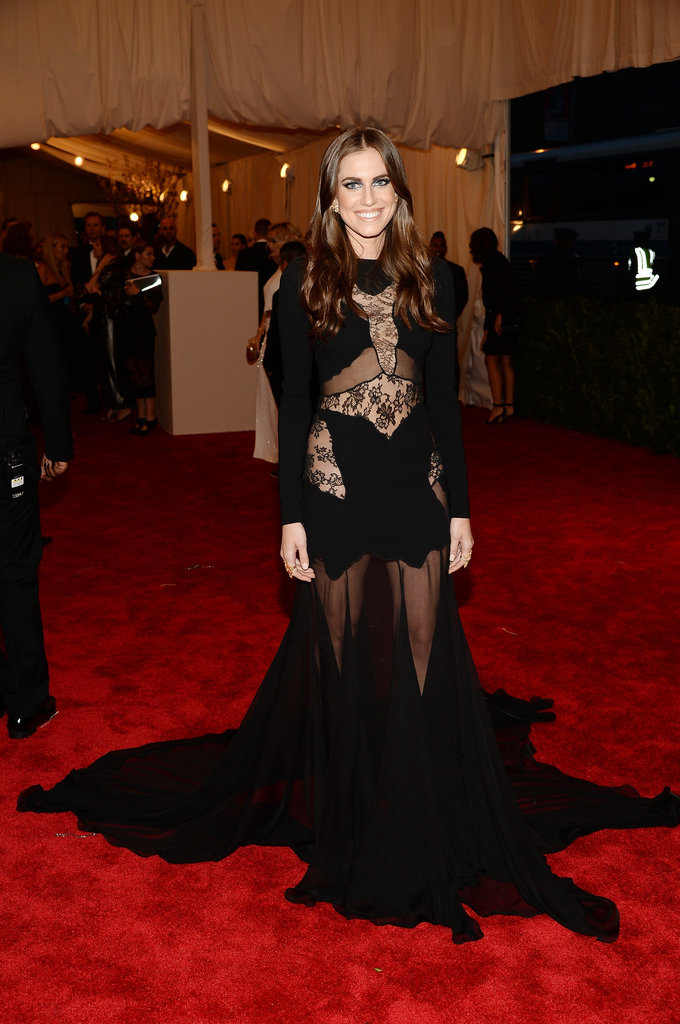 Allison Williams was enveloped in a black sheer lace gown by Joseph Altuzarra, Repossi jewels, a Roland Mouret clutch, and Saint Laurent pumps.