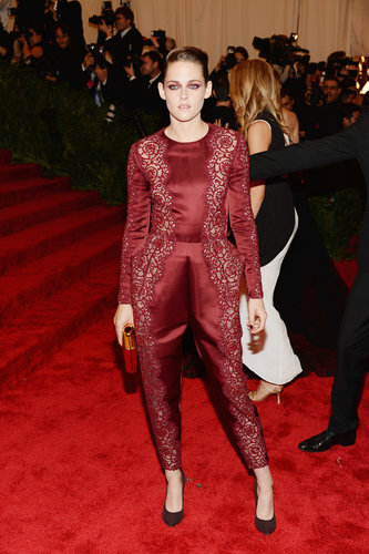Kristen Stewart ditched a gown in lieu of a red lace Stella McCartney jumpsuit.