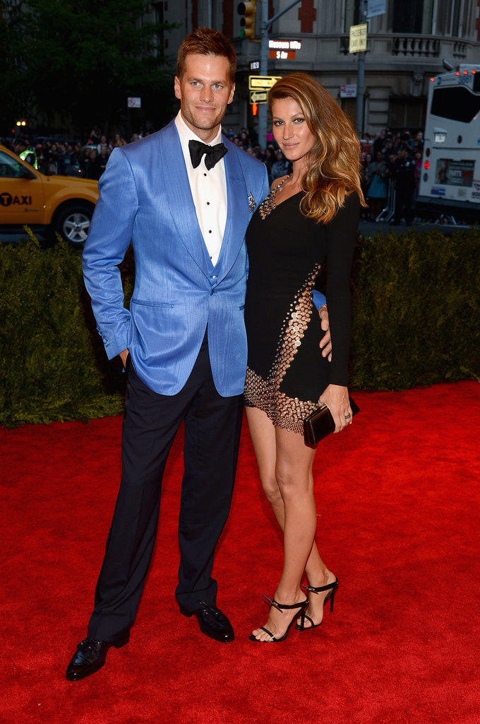 A leggy Gisele Bündchen flashed some skin in a dress that evoked Versace's famed safety-pin dress. Husband Tom Brady didn't look half bad, either.