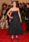 Jennifer Lawrence was the epitome of sophisticated in her black beaded Christian Dior fit-and-flare gown, black netted Jennifer Behr veil, and Brian Atwood platforms.