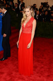 Teresa Palmer didn't skimp on the bright in a red plunging gown and Maria Canale for Forevermark jewels.