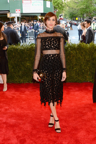 Alexa Chung's black Erdem dress featured the most delicate of details: a ruffle neck, sheer sleeves, and fringe skirt.