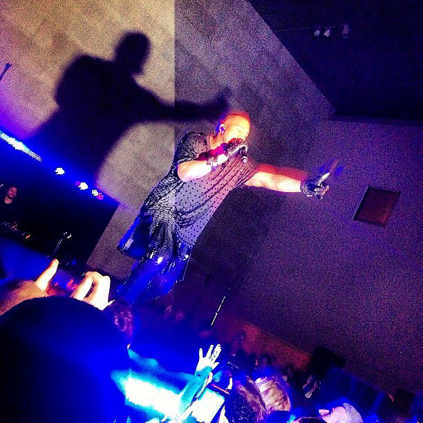 Coco Rocha snapped a photo of Kanye West's afterparty performance (he wore a sparkly Givenchy tee, naturally). Source: Instagram user cocorocha