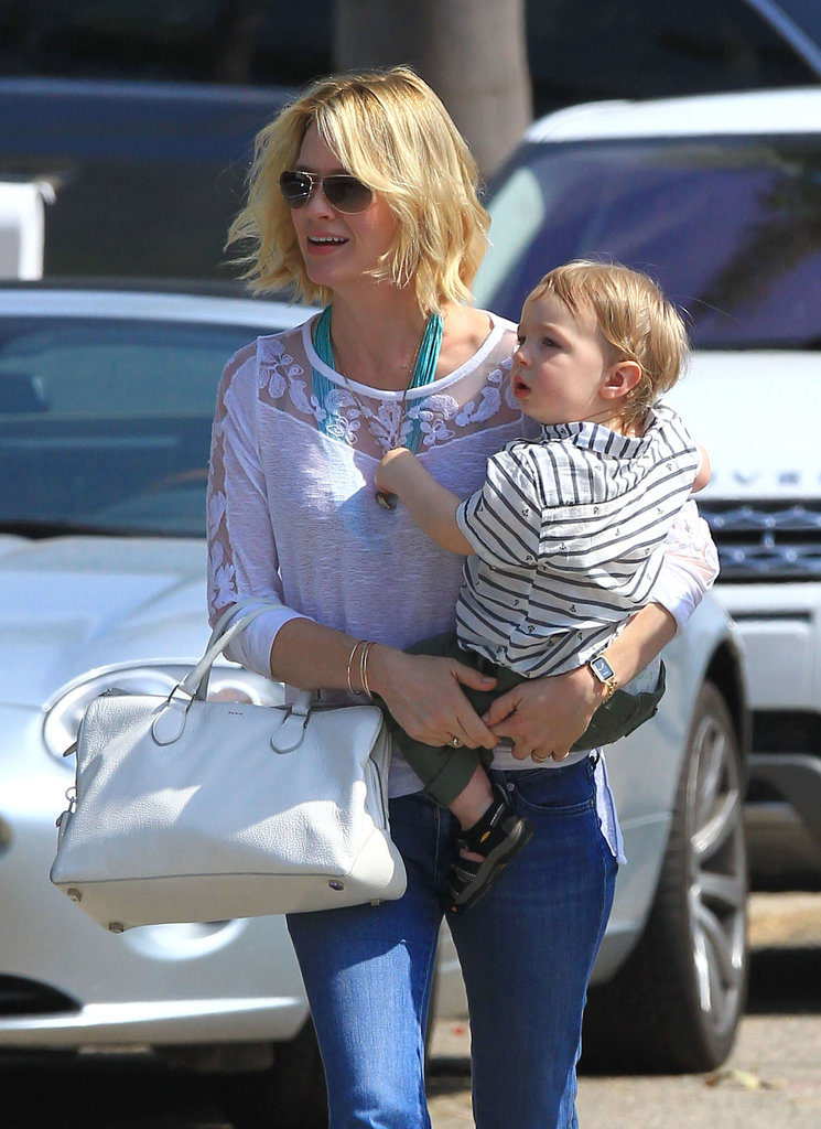 January Jones toted her son, Xander, through LA.