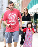 Adam Sandler held daughter Sunny's hand after leaving a restaurant in LA.