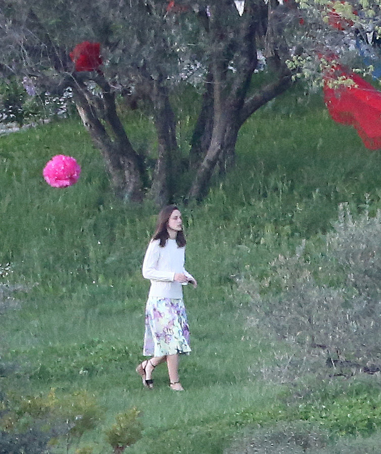 While she may have switched things up with her outfits, one thing remained: Keira Knightley committed to an ultracasual vibe on her wedding day. She sported stripes and red shorts at one point, and in this sighting, she opted for an oversize knit sweater, floral midi skirt, and Summer wedges.