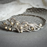 Add some sparkle to your look with a vintage-inspired wedding headband ($95).