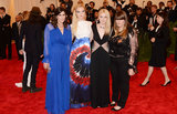 Elle Fanning and Dakota Fanning at the Met Gala 2013.