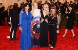 Elle Fanning and Dakota Fanning at the Met Gala 2013.