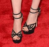 Kate Mara wore black ankle-strap cutout heels.