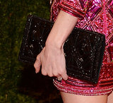 Kate Bosworth carried a black shimmering clutch.