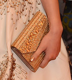 Hailee Steinfeld carried a Jimmy Choo clutch.
