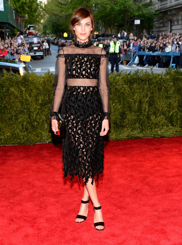 Alexa Chung wore a punky Erdem peek-a-boo dress to the Met Gala last night that she paired with strappy black sandals and black hotpants!