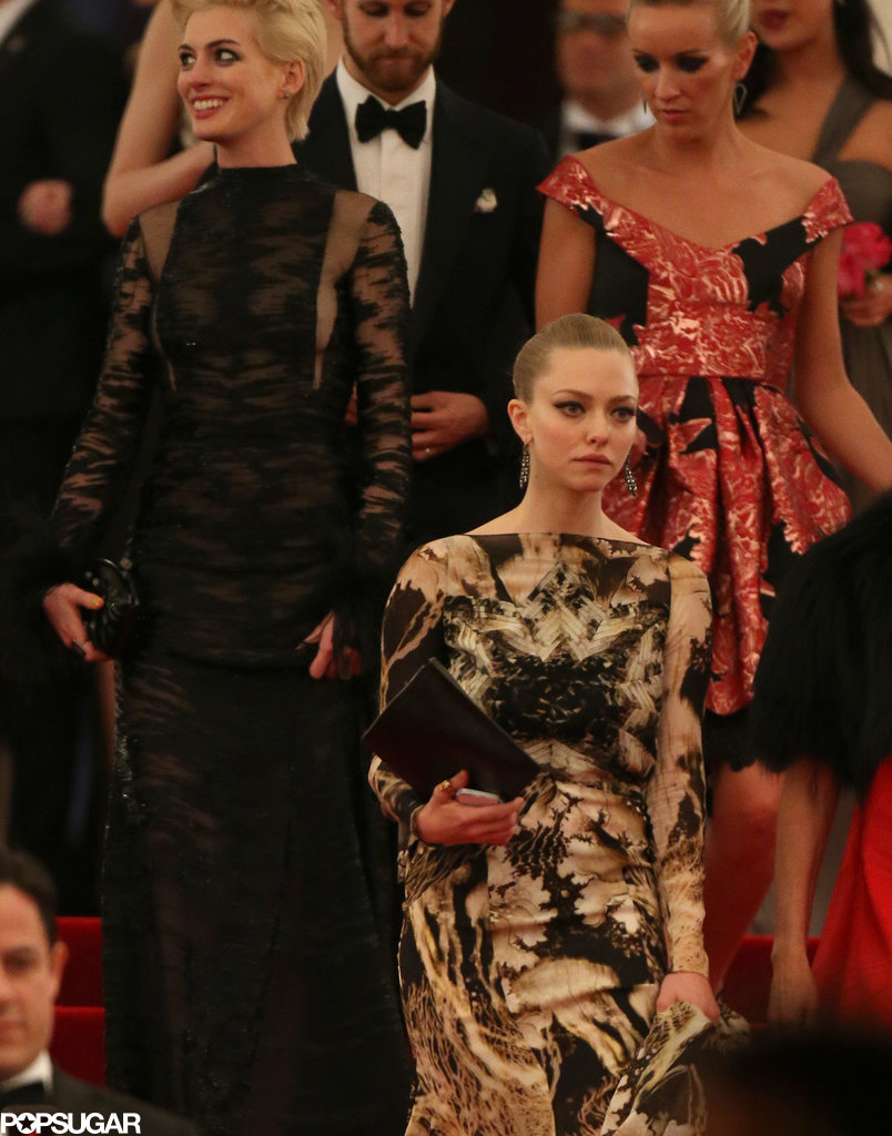 Amanda Seyfried and Anne Hathaway crossed paths while leaving the Met Gala.