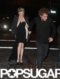 Michelle Williams held hands with a male companion leaving the Met Gala afterparty in NYC.