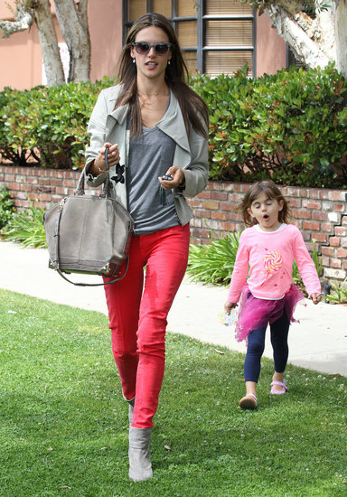 While paying a visit to the doctor in Santa Monica, CA, Alessandra Ambrosio kept her top half and Alexander Wang bag neutral but really punched things up on bottom with her red skinny jeans.