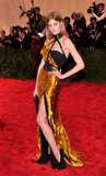 Constance Jablonski's hand-sculpted metal Wes Gordon gown featured a thigh-high slit.