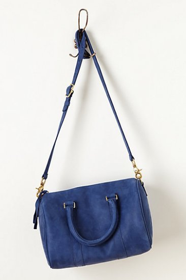 Your classic, take-everywhere leather bag doesn't need to stay within the neutral family color to be a smart buy. This Anthropologie style ($478) has all the trappings of your trusty favorite, but in a more alluring marine.
