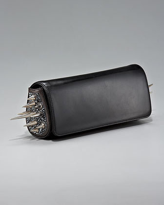You're looking at the exact Christian Louboutin black spiked clutch ($1,995) that Jessica Alba carried at this year's Met Gala (Miranda Kerr brought the silver version). Business in front, party on the sides.