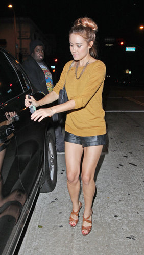 Conrad styled her leather shorts with a mustard sweater and strappy leather sandals during a Hollywood outing in 2012. Lesson from Lauren: counterbalance short shorts with a conservative top.