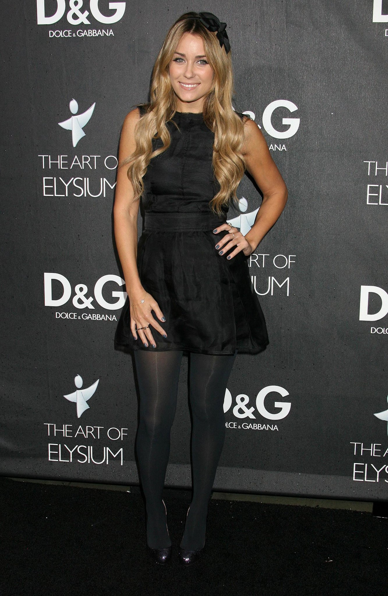 Lauren topped her flirty black minidress with breezy beach waves and a bow headband at the D&G flagship boutique opening in Beverly Hills in 2008. Lesson from Lauren: turn up the sweetness with a bow accessory.
