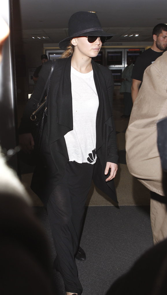 Jennifer Lawrence wore a black hat and sunglasses.