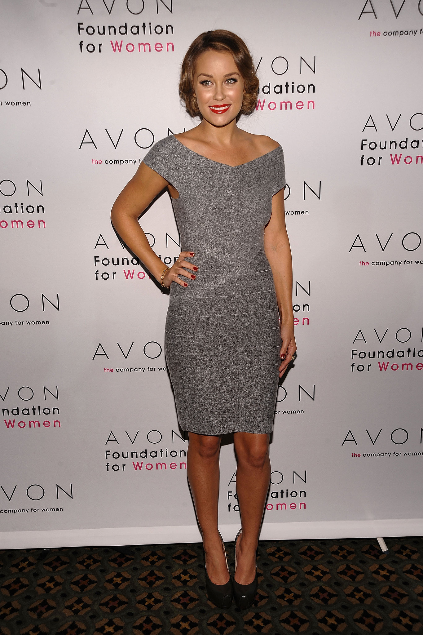 LC went for a grown-up look for an Avon event in 2009, wearing a curve-hugging Hervé Léger dress and YSL Tribute pumps. Lesson from Lauren: a red lip and coordinating nail polish oozes ladylike sophistication.