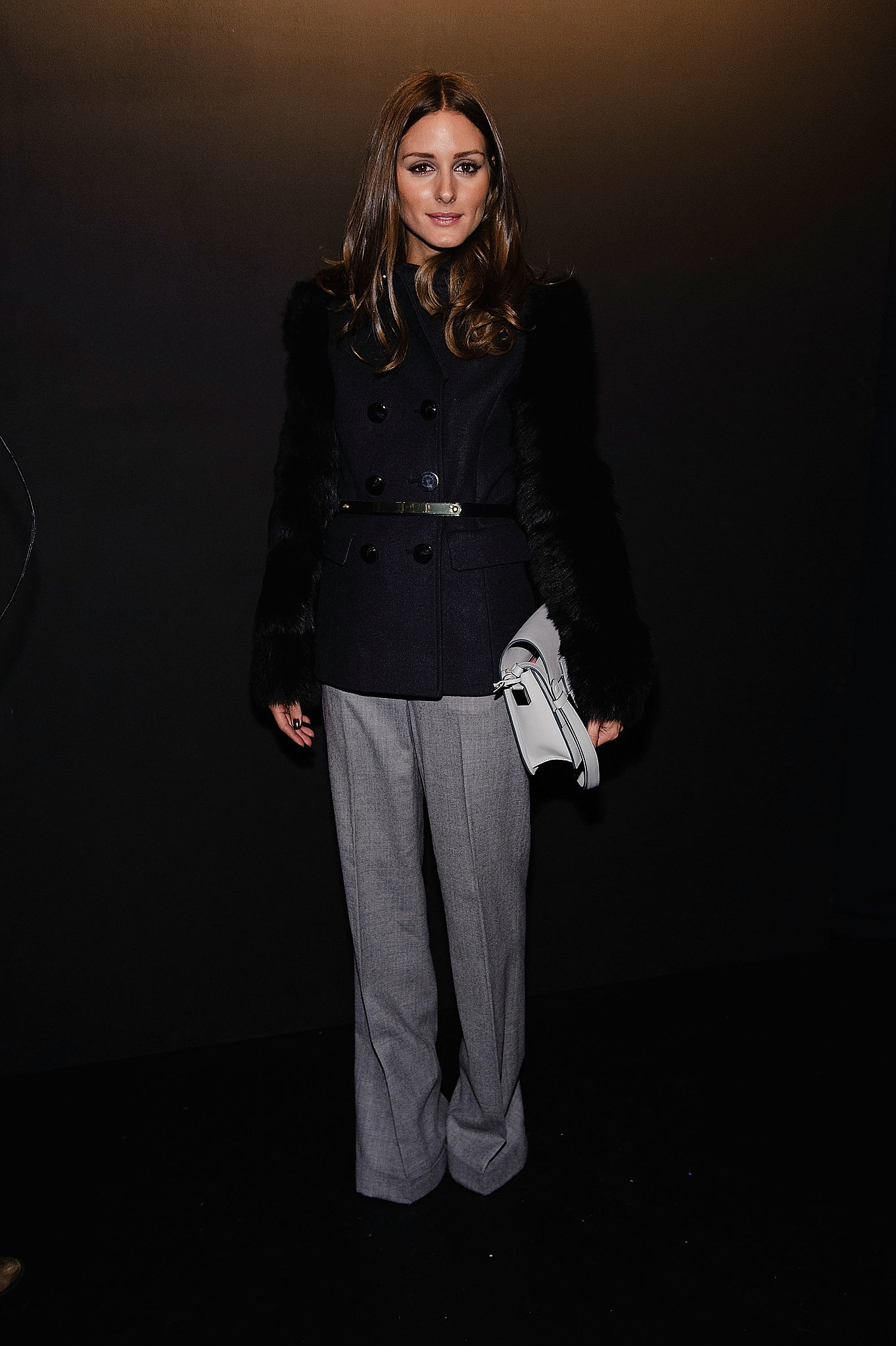 Olivia went sleek and sophisticated in a shearling-sleeved coat and wide-legged trousers, both by Monika Chiang, at Lincoln Center in NYC.