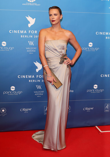 For a more subtle approach, look no further than Charlize Theron's gray satin Gucci strapless gown at the Cinema For Peace Gala in Berlin. Add a jeweled brooch to take the dress from simple to simply dazzling.
