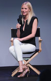 Gwyneth Paltrow was minimalist with a touch of tough in a black plunging Barbara Bui top, white cropped trousers, and nude studded sandals during a talk at an Apple store in NYC.