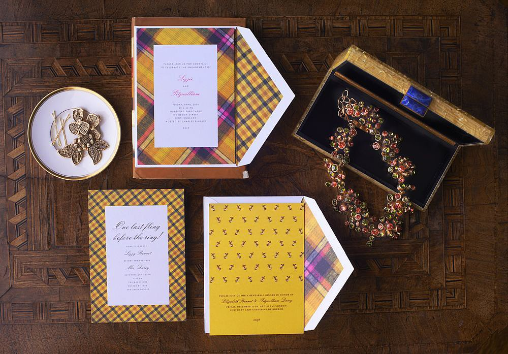Bring on the party and the plaid! The entertaining options are endless with these plaid picks. Or consider the solid yellow paper (prices vary) that reverses the look by incorporating the tartan onto the envelope sleeve. Either way, we can't get enough of this colorful combo.