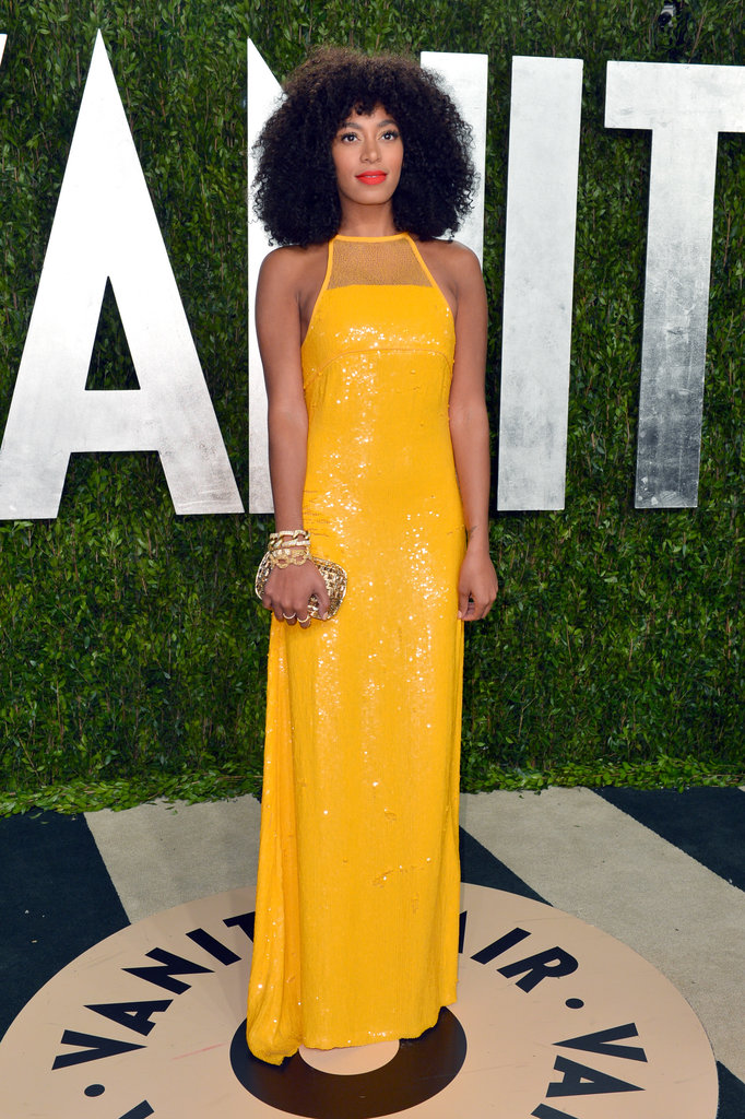 The yellow sequined Emilio Pucci gown Solange Knowles showed off at the 2013 Vanity Fair Oscar afterparty would no doubt add a ray of sunshine to a black-tie affair. To balance the bright hue, add chunky gold jewelry for a touch of tough.