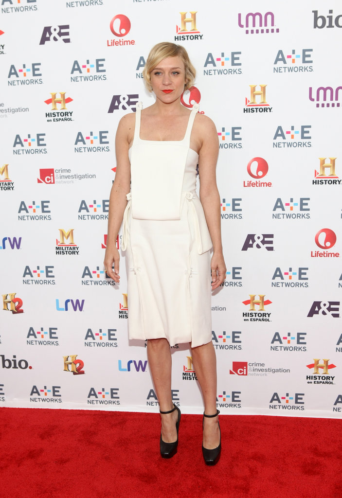 Chloë Sevigny mismatched her white Christopher Kane knee-length dress with black platform ankle-strap pumps, then added a bold red lip at the A+E Networks upfronts event in NYC.