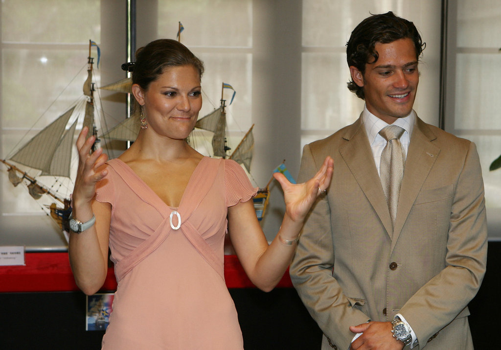 A light suit flattered his dark tan when he visited a Shanghai maritime museum with Princess Victoria in 2006.