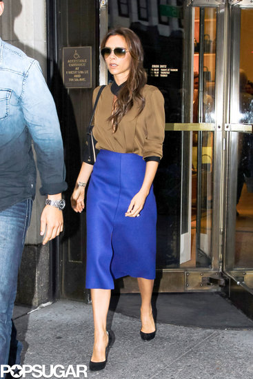 Victoria Beckham wore a blue skirt.