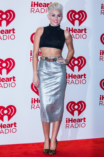 Miley went rocker-chic in September 2012 for the iHeartRadio Music Festival, where she showed off her figure in a silver metallic Moschino skirt. She upped the sex factor with a cropped, slightly sheer black top and leopard-print pumps.