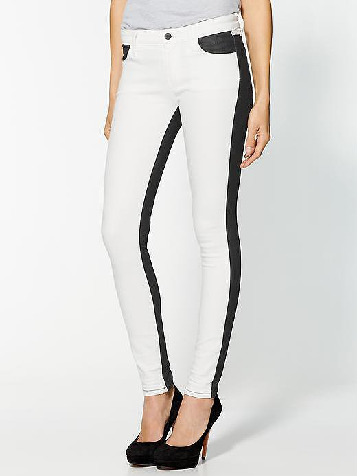 If you're not quite ready to embrace white jeans, Koral's colorblocked pair ($149) is genius. You'll rock the bright basic from the front, but in the back, it's all about slimming black.