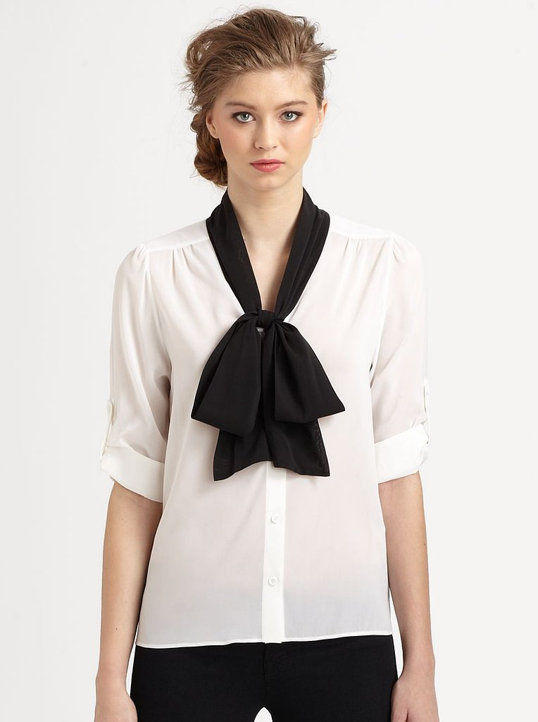 The quickest way to add a bit of feminine polish to a look just might be a bow-neck blouse. Put the tie front and center with a contrasting color palette like this Alice + Olivia blouse ($264).