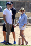 Reese Witherspoon held hands with Jim Toth.
