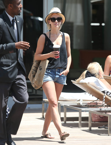 Julianne Hough covered up her halter bikini with a black tank and denim cutoffs during a stroll in Miami.
