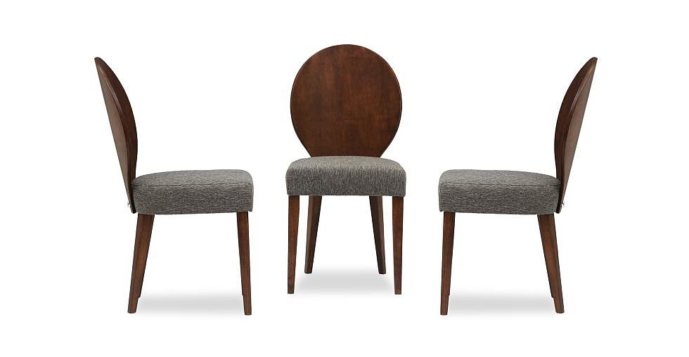With a beautifully crafted round back and slender legs, the Olivia Dining Chair ($199) reminds us of Philippe Starck's aluminum Kong Chair for Emeco ($1,365-$2,695), but its cocoa-hued oak stain makes it a much more versatile piece. We just wish the brand offered more upholstery options. We'd spice this chair up with a lively patterned seat or perhaps a rich performance velvet.