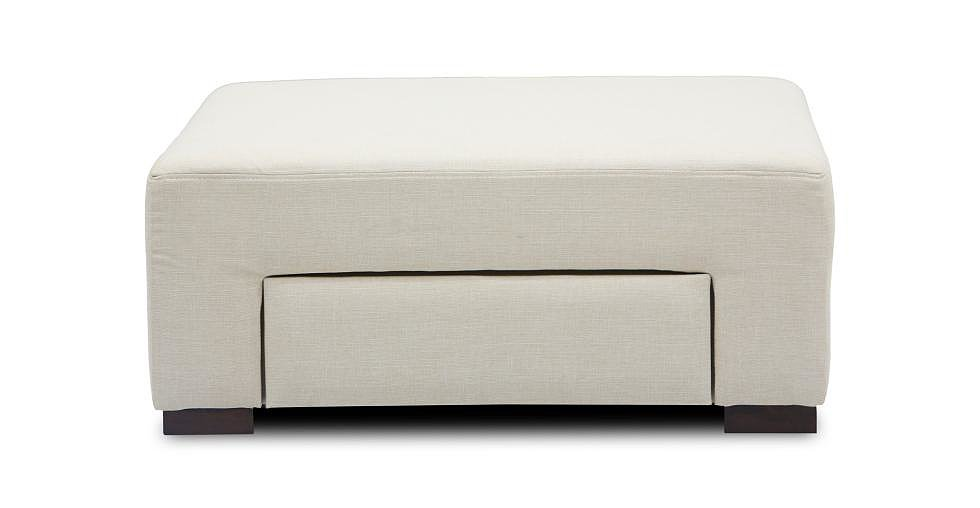 We've seen our fair share of storage ottomans, but we love that the Greece Ottoman's ($349) space-saving unit is an under-seat drawer. And at 35.8 square inches, it's not just a footrest.