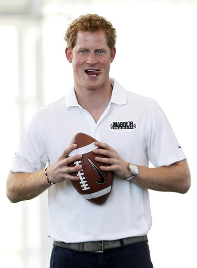Prince Harry threw around a football inside the US Air Force Academy's football training center.