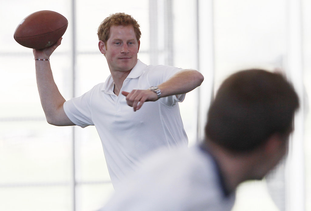Prince Harry tossed around a football on Sunday while visiting Colorado Springs, CO, and touring the US Air Force Academy's football practice space.